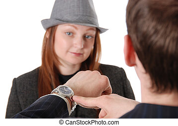 The businessman points a finger at a wrist watch