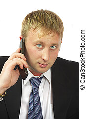 The businessman speaks by phone. Conducts conversation.