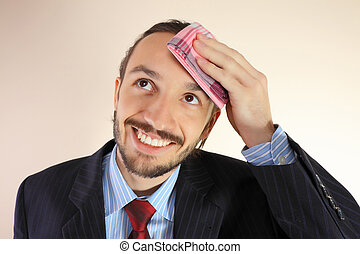The businessman wipes a forehead by kerchief