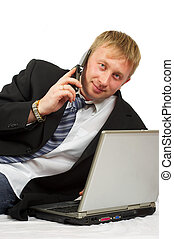 The businessman with phone and laptop