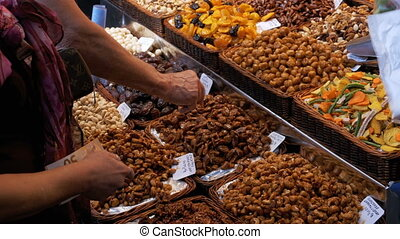 The buyer gives money to the seller for purchased dried...