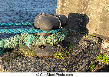The cable is tied to the pier