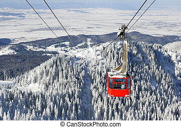 The Cableway - Winter landscape with a red cable car.