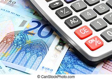 The calculator and money. - The calculator and money .