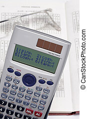 The calculator and points lie on the table with the data