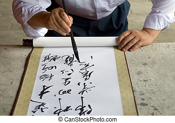 The Calligrapher - A Chinese calligrapher at work writing on...