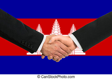 The Cambodian flag and business handshake