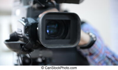 The camcorder while reporting on a tripod