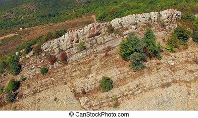 the camera is moving over the ridge. bird's eye view. - the...