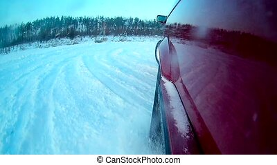 The camera is on the left wing of the car, which drifts in...