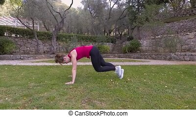 Woman In Sports Suit Doing Cardio Exercises