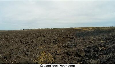 the camera moves on a plowed field. Slow motion. - the...