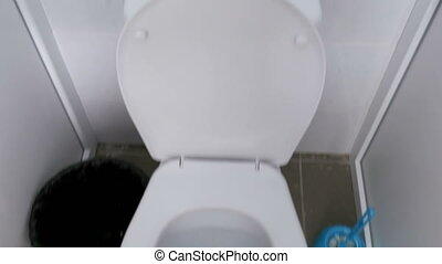 The Camera Shakes Moves Inside the Public Toilet. Close-up...