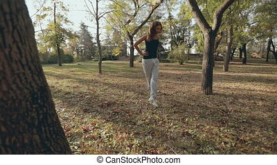 The camera shoots sports girl during doing exercises in the...