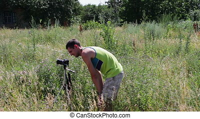 The cameraman shoots natural landscape on the video camera...