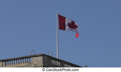 The Canadian flag flies on the roof.