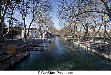 The canal in Annecy, France ringed by the beautifully trees.