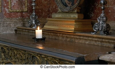 The candle burns in the cathedral. Interior of an old church