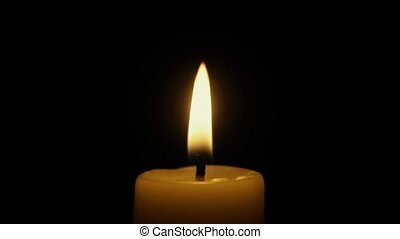 The candle goes out in the wind. Slow motion - Candle burns...