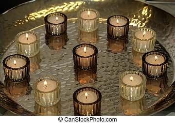 The candles are on the table