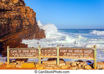 South Africa. Powerful ocean surf. Cape of Good Hope at the southern tip of the Cape Peninsula. White foam of the ocean surf. Bright sunny summer February day.