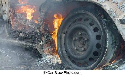 The car burns a wheel, burning tires on the car wheel, a...