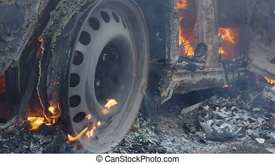 The car burns a wheel, burning tires on the car wheel