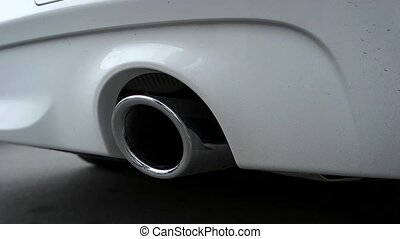 The car chrome exhaust pipe close-up