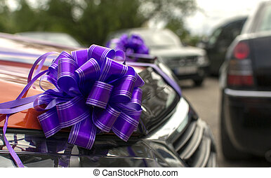 The car decorated with bows as a gift or a wedding cortege ...