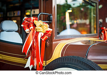 The car decorated with bows - Vintage car decorated with a ...