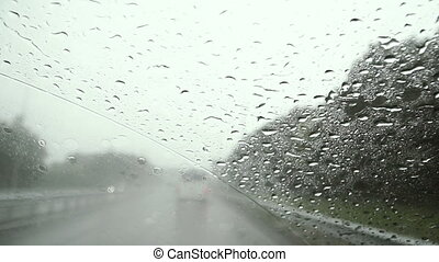 The car goes in rainy weather.