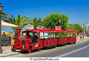 The car in the style of an old steam locomotive in the resort to