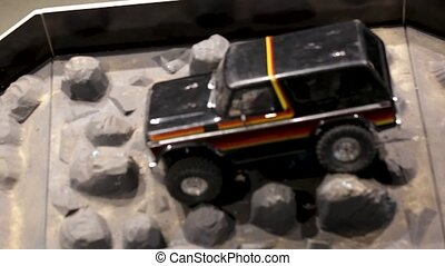 The car is running over an offroad terrain track. Free time....