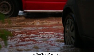 The car moves along a flooded road. Slow motion.
