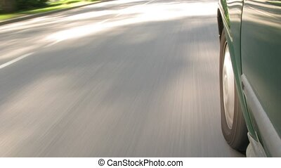 The car moves on highway, a shade from the car on asphalt.