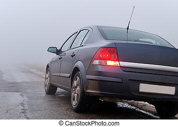 The car on a foggy road