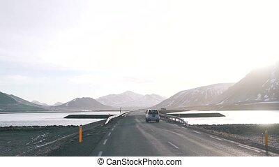 the car rides on an empty road in Iceland