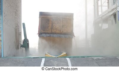 The car truck pours out corns or grains of wheat into the...
