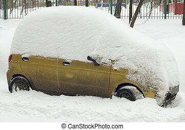 The car under snow in city Moscow