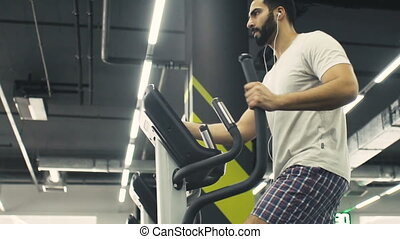 The Cardio Cycling Workout - Bearded sexy man wears white...