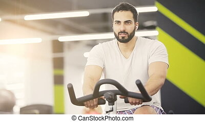 The Cardio Workout - Athlete man wears white t-shirt does...