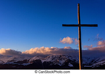 The Carpathian mountain with cross in the foreground