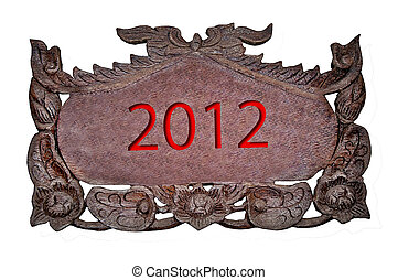 The Carving wood of 2012 isolated on white background