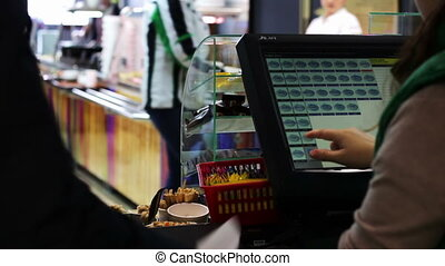 The cashier working the store. - Woman cashier working...