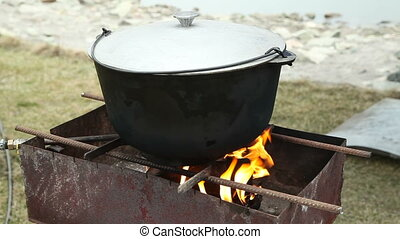 The cast-iron pot is on fire. Russian holiday Maslenitsa