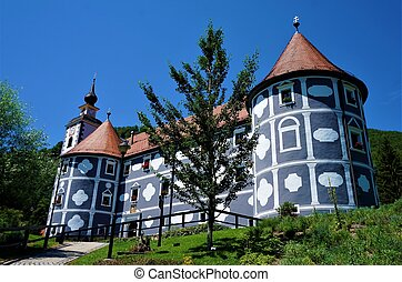 The castle in Olimje behind a tree