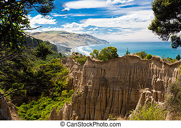 The Cathedrals eroded clay cliff of Gore Bay, NZ - Badlands...