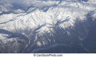 The Caucasus canyon at sunny day, aerial view from high altitude