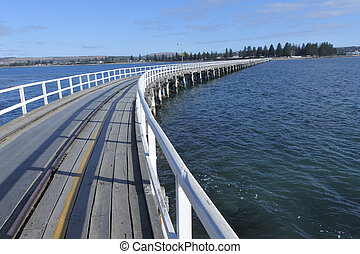 Landscape view of the Causeway leading to Victor Harbor town from Granite Island in South Australia State, Australia.