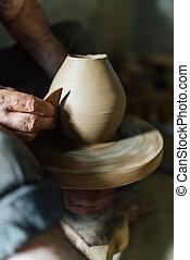 The ceramist make vase from clay - The ceramist make vase...
